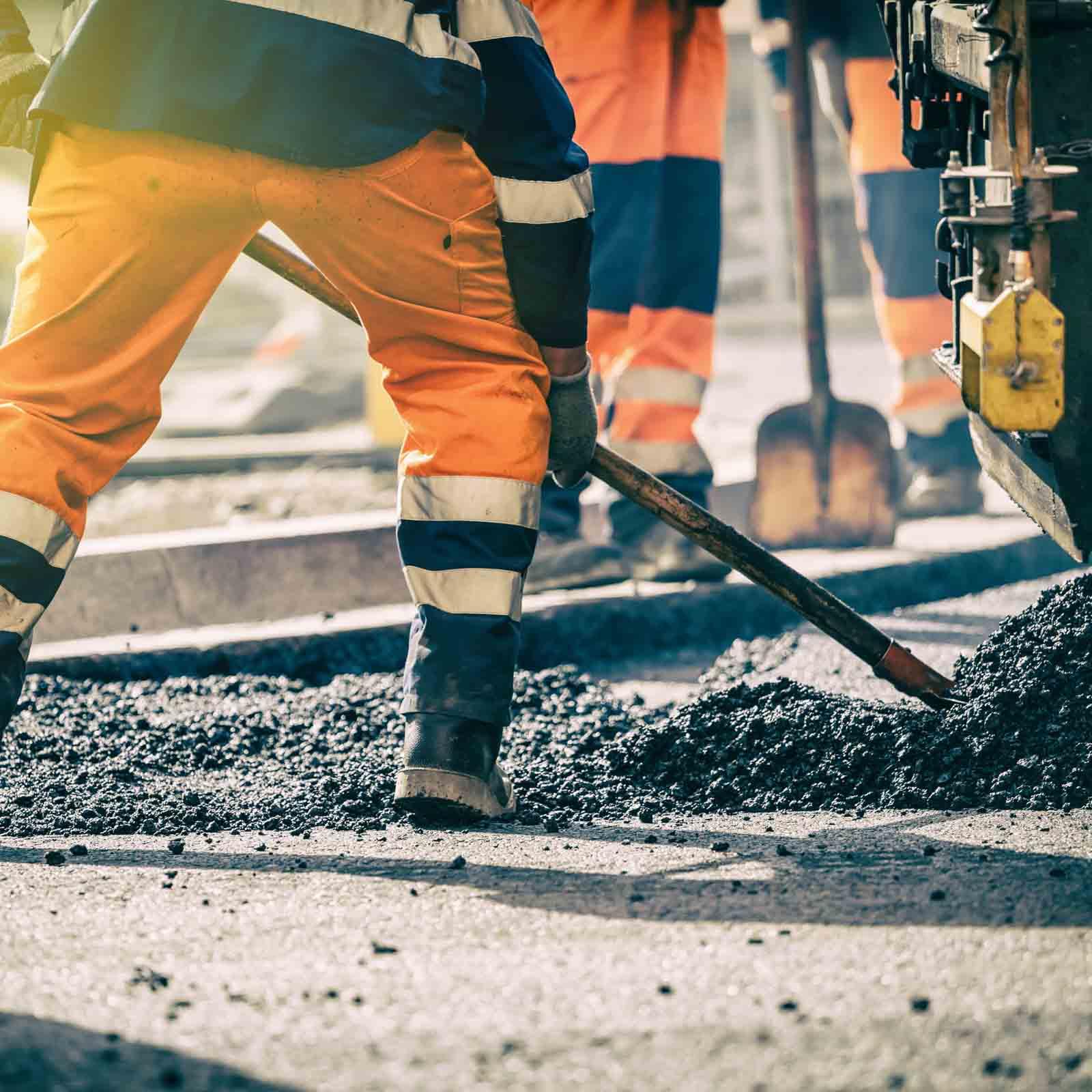 construction-worker-shoveling-asphalt
