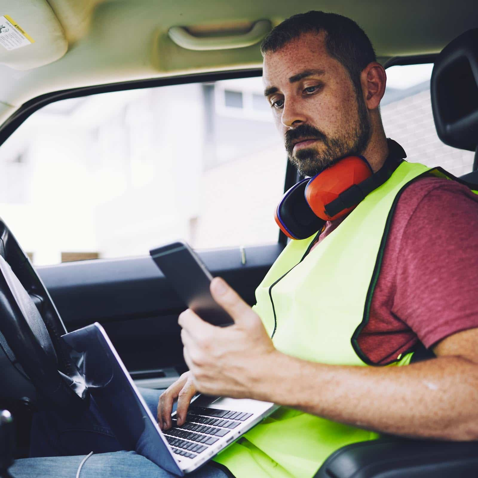 construction-worker-working-in-his-car
